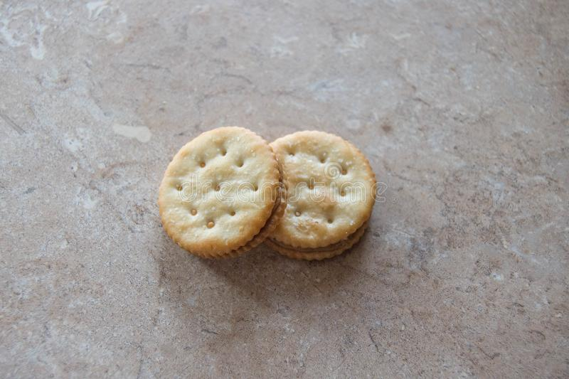 Two identical peanut butter crackers laying on counter royalty free stock photo