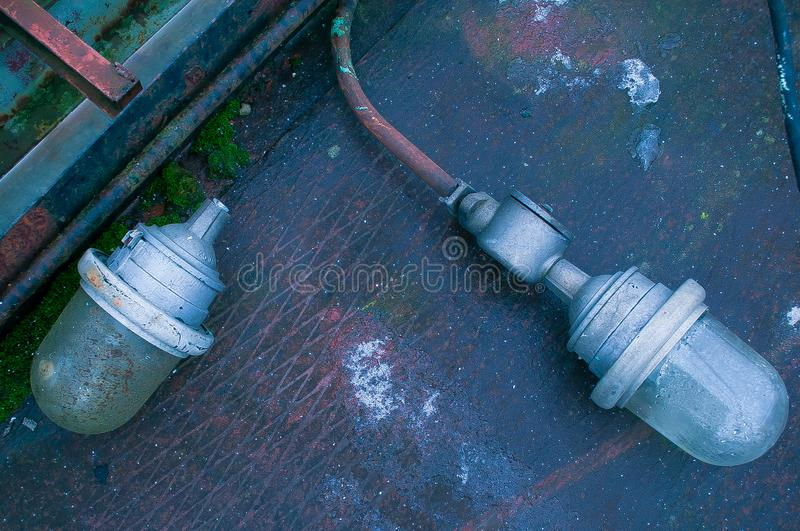 Two inactive street lights. From area of abandoned factory stock photography