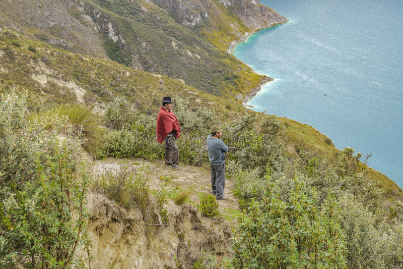 Two Indian Watching the View at Quilotoa Lake, Ecuador stock image