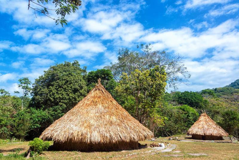 Two Indigenous Huts. Indigenous huts in Tayrona National Park in a tiny village populated by Kogui Indians stock photo