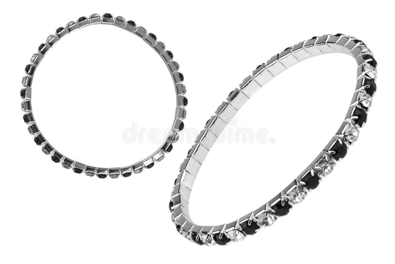 Two instances of an elastic metallic silver bracelet with black and white semiprecious stones, isolated on white background,. Clipping paths included royalty free stock photos