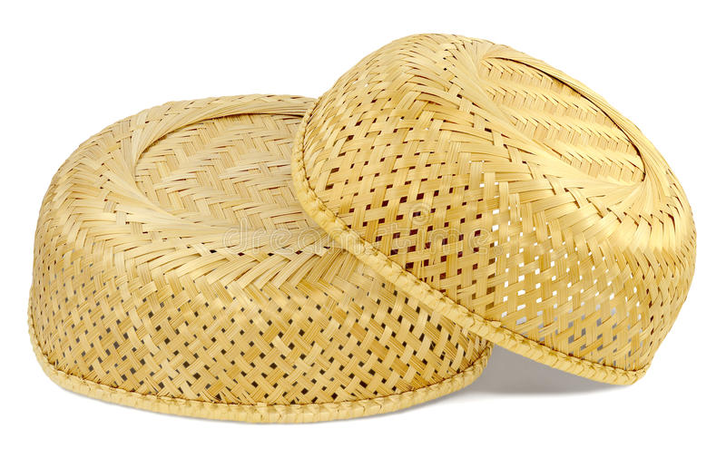 Two inverted wicker basket. Material straw light yellow color, small basket lies on big basket, on white background royalty free stock photography