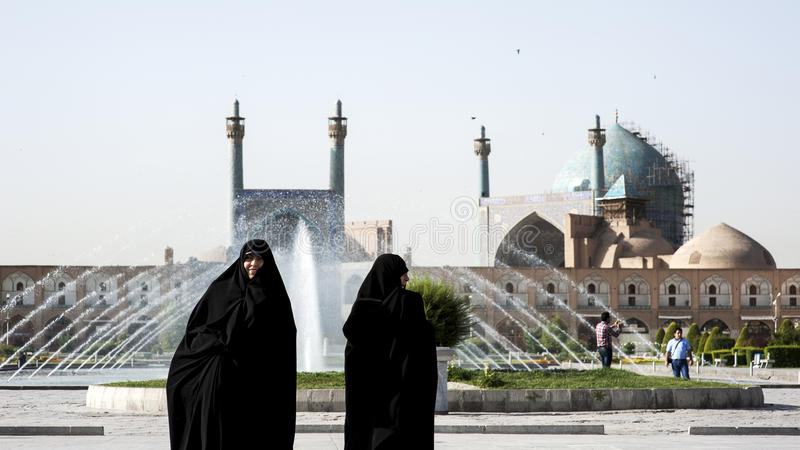 Two Iranian women on Imam Square,Isfahan Iran stock photos