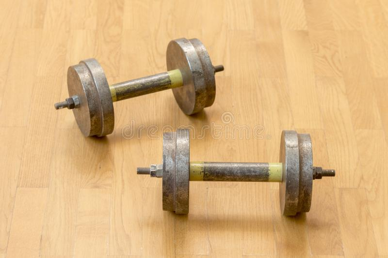 Two iron dumbbells on the floor. the concept of a healthy lifestyle and sport. stock photo