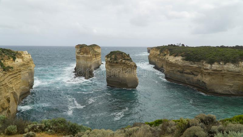 Two isolated cliffs and rock formations along The Great Ocean Road, caused by water erosion, Australia. Two isolated cliffs and rock formations along The Great stock photo