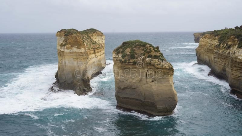 Two isolated cliffs and rock formations along The Great Ocean Road, caused by water erosion, Australia. Two isolated cliffs and rock formations along The Great royalty free stock photography
