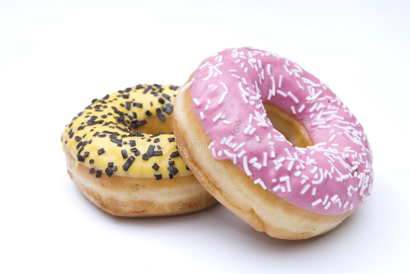 Two isolated doughnuts royalty free stock image