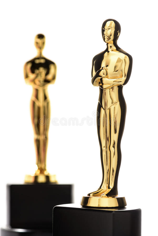 Two Isolated Golden Statuettes stock images
