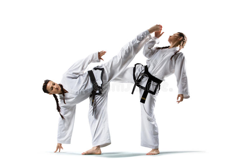 Two isolated professional female karate fighters stock images