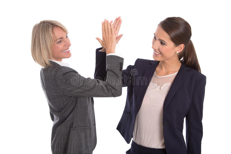 Two isolated successful woman working in a team. Isolated portrait with two businesswoman. royalty free stock photo