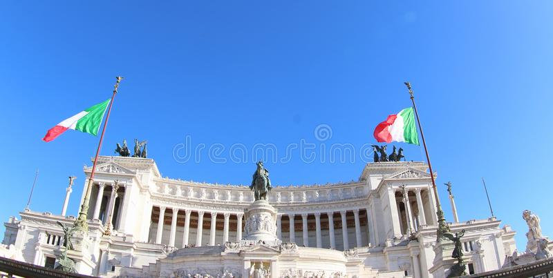 Italian flag at Altar of the Fatherland, Rome. Two italian flags flutter in front of the Altare della Patria, also known as Monumento Nazionale a Vittorio royalty free stock photos