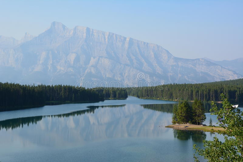 Two Jack Lake Canada. Mountain reflects in river stock images