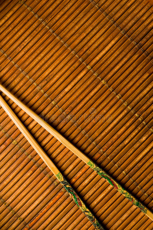 Japanese Chop Sticks on Bamboo royalty free stock image