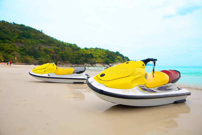 Two Jetskis On Sandy Beach Royalty Free Stock Photo