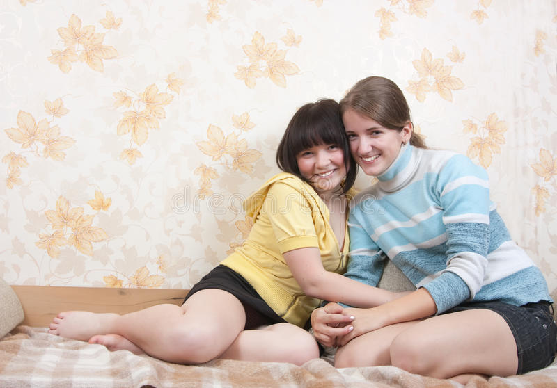 Download Two joy girl on sofa stock photo. Image of love, house - 12629590