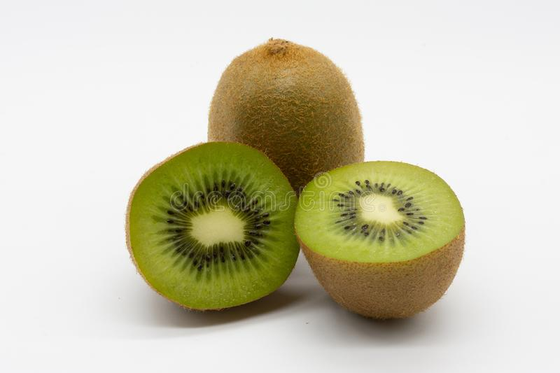 Two juicy kiwis, one of them has already been split royalty free stock image