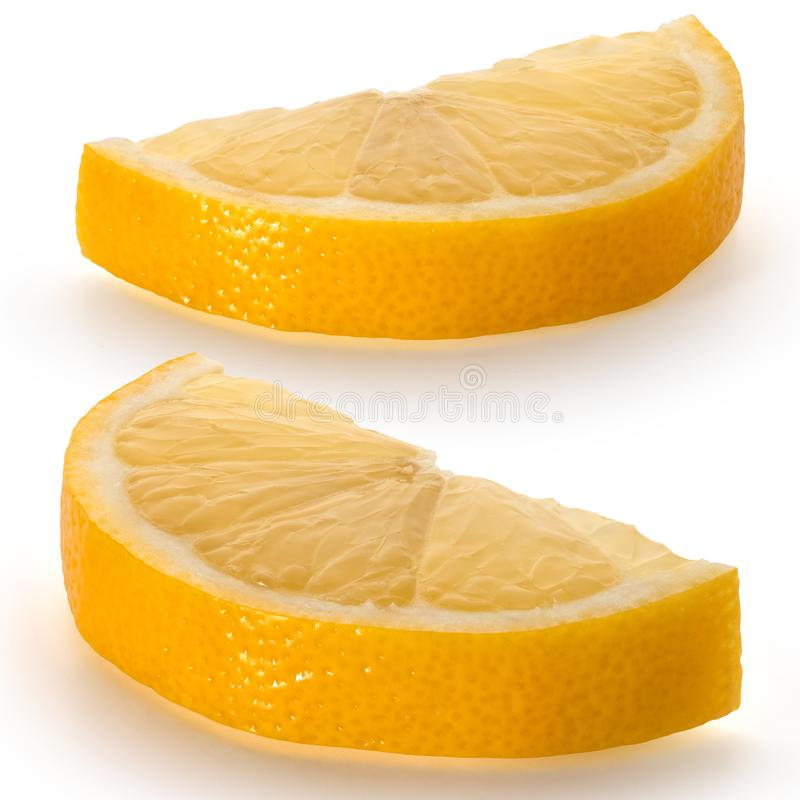 Two juicy lemon slices on a white. Background royalty free stock photography