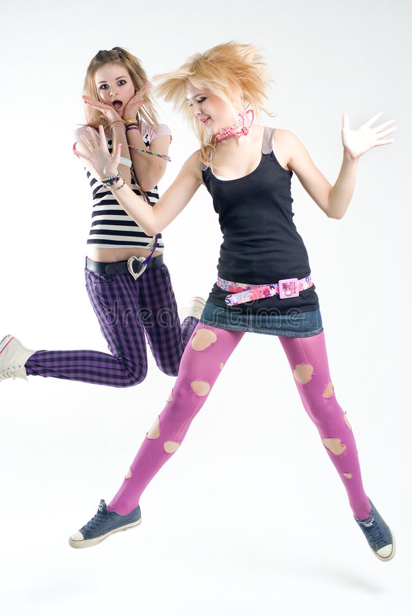 Two jumping punk girls royalty free stock images