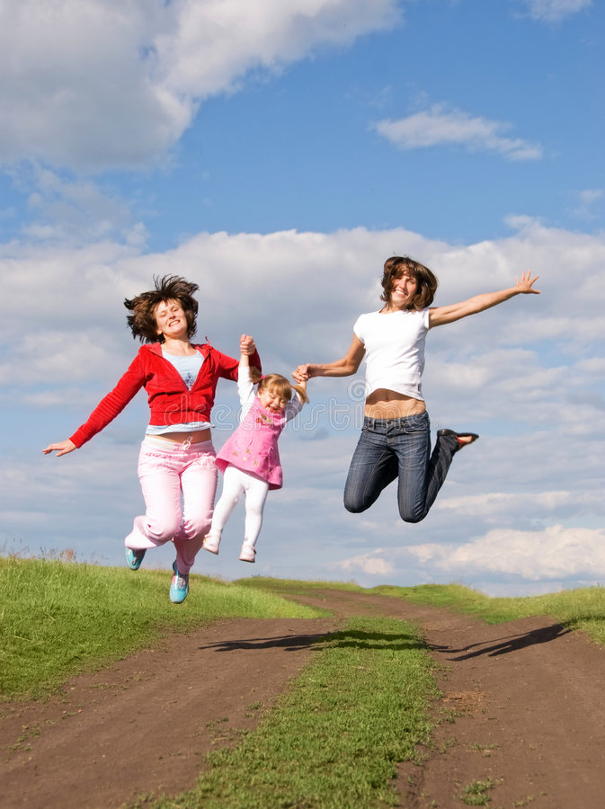 Download Two Jumping Women And One Little Girl Stock Photo - Image of casual, free: 5987300