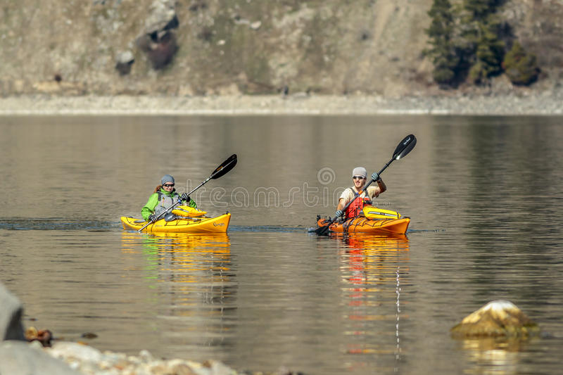 Two Kayakers in lake. royalty free stock photo