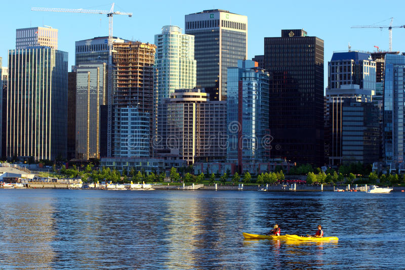 Two kayakers in Vancouvers inner harbour royalty free stock images
