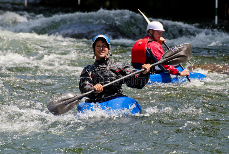 Two kayakers in white water royalty free stock photography