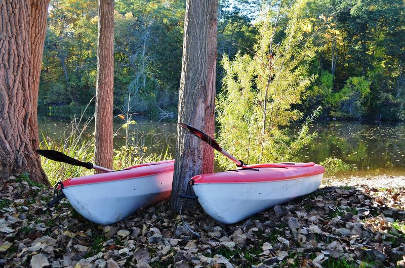 Two Kayaks at the ready. On the banks of a river in rural Michigan, USA royalty free stock photo