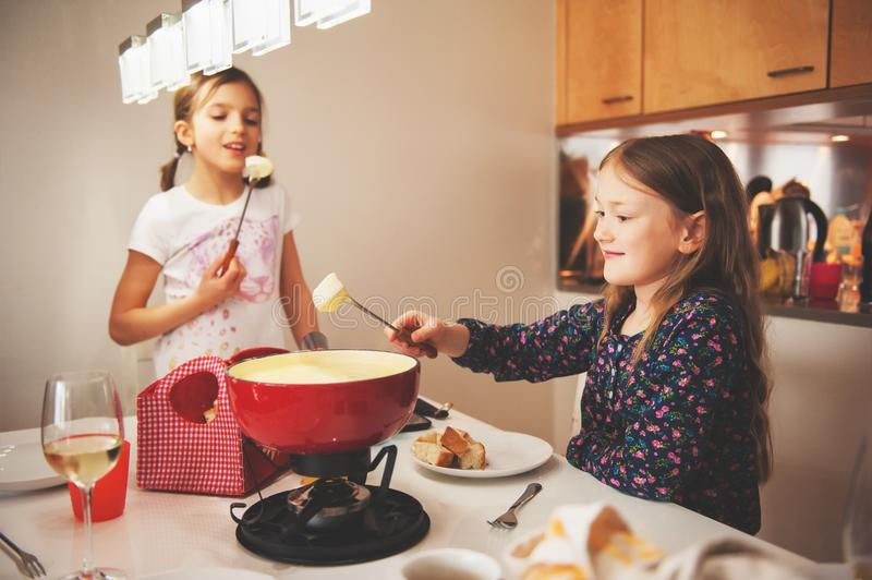 Kids eating fondue stock photography