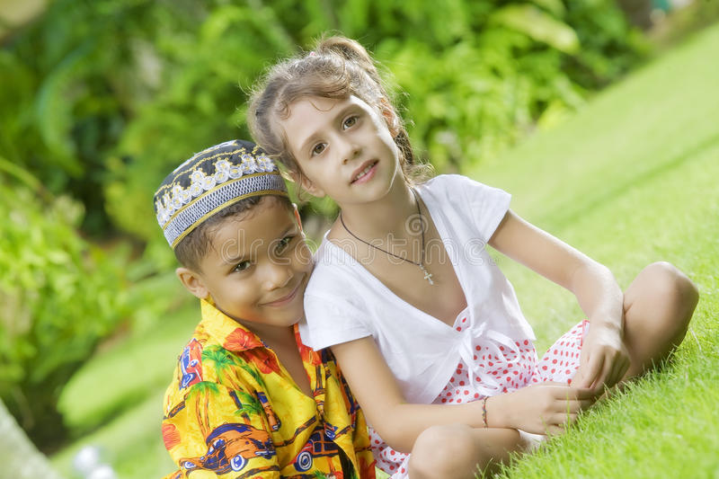 Two kids. Portrait of little kids having good time in summer environment royalty free stock photos