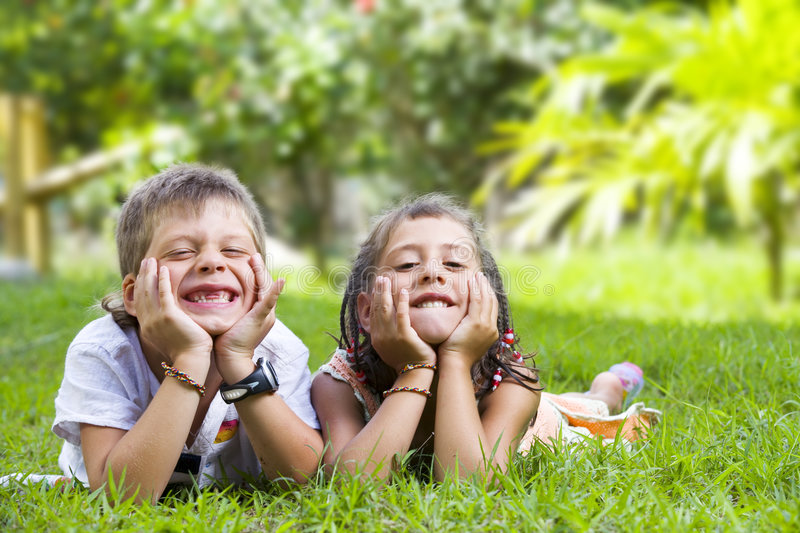 Two kids. Portrait of little kids having good time in summer environment stock images