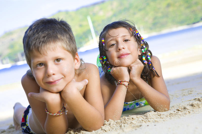 Two kids. Portrait of little kids having good time in summer environment royalty free stock images