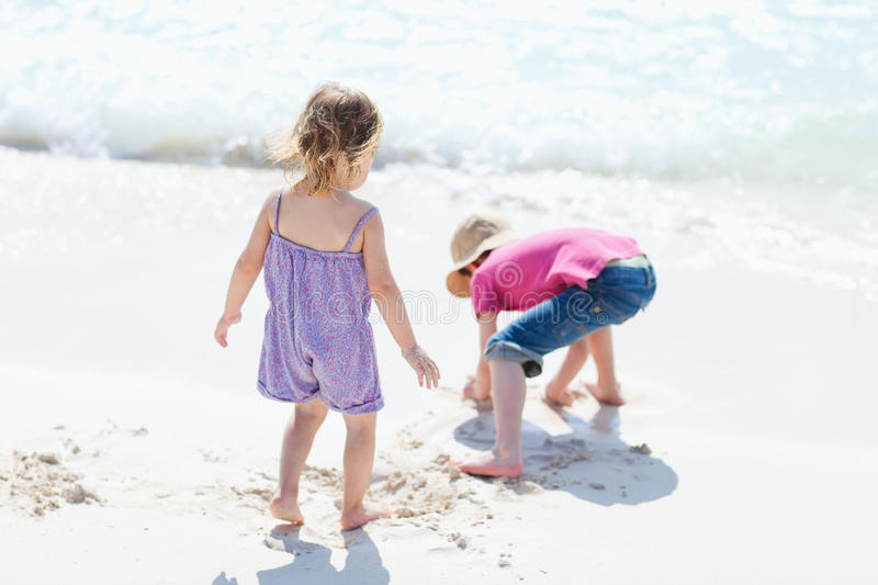 Download Two kids at beach stock image. Image of playful, playing - 19965481