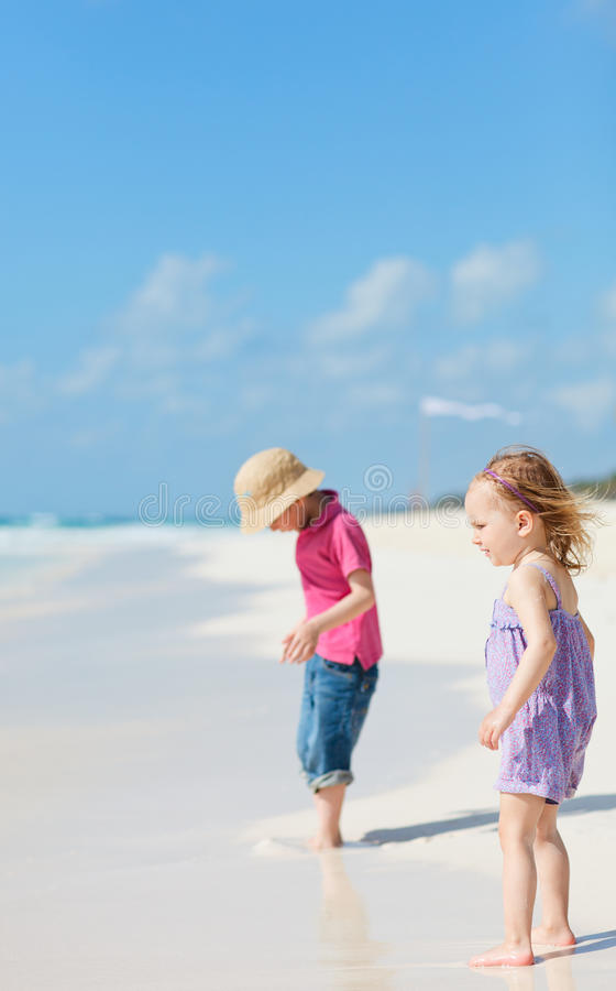 Download Two kids at beach stock image. Image of little, tropical - 19965619