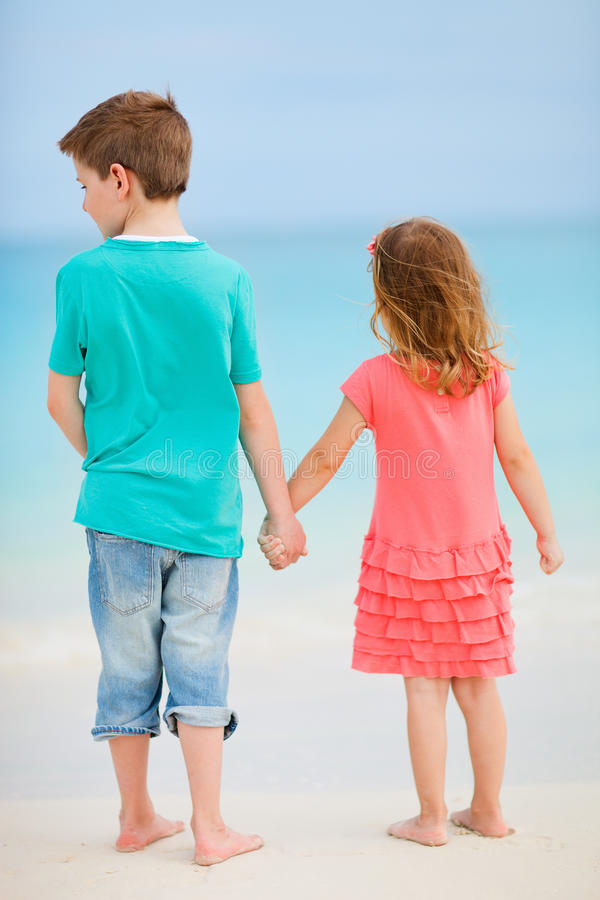 Download Two kids at beach stock image. Image of portrait, sister - 27872109