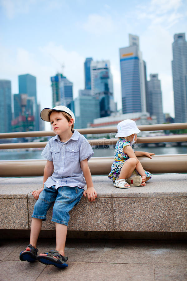 Two kids in big modern city royalty free stock images