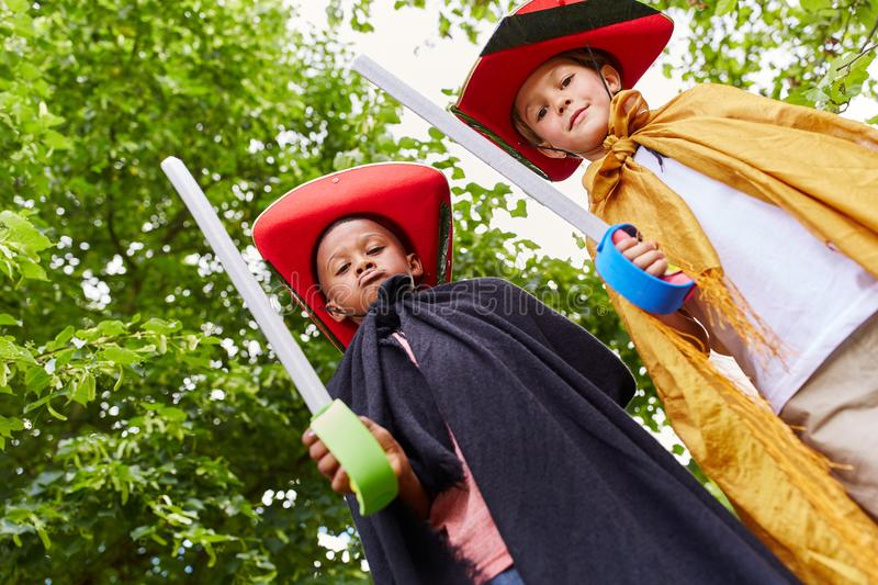 Two kids in carnival as pirates stock photos