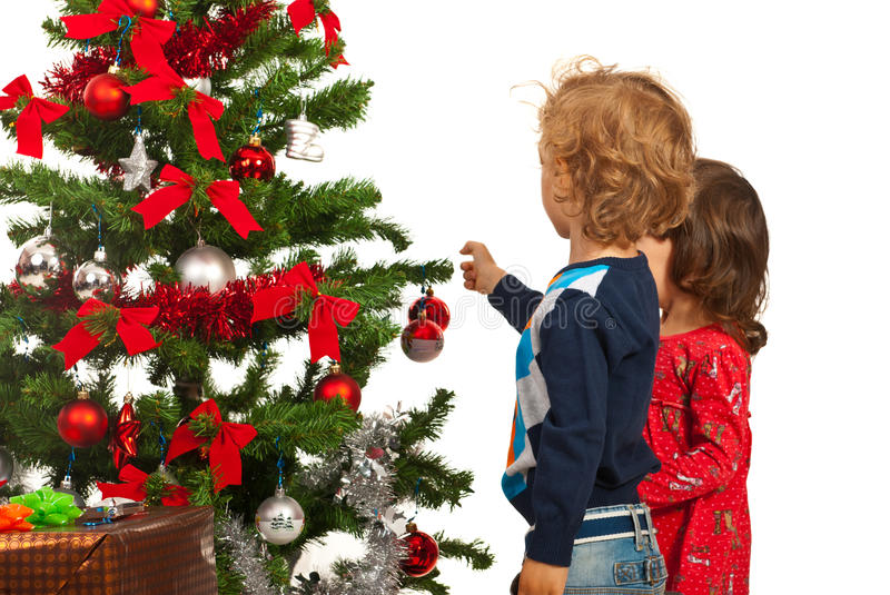 Two kids decorate Christmas tree. Two little kids decorate Christmas tree isolated on white background stock image