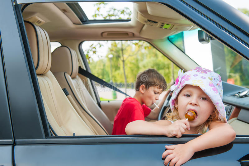 Two kids is going by car without parents. royalty free stock image