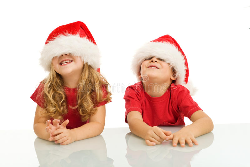 Two kids having fun at christmas time stock photography