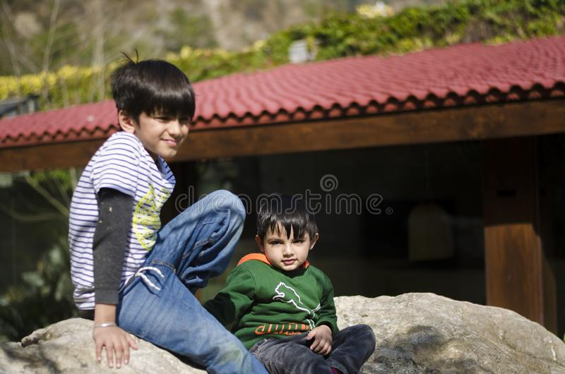 Two kids having fun together royalty free stock photo