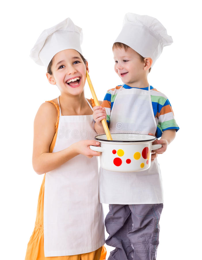 Two kids with pan and big ladle royalty free stock photo