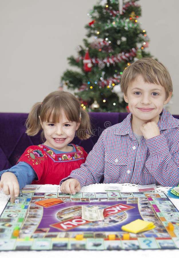 Children play a table game royalty free stock images