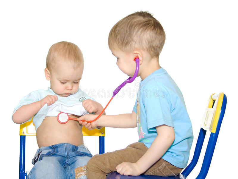 Two kids playing doctor royalty free stock images
