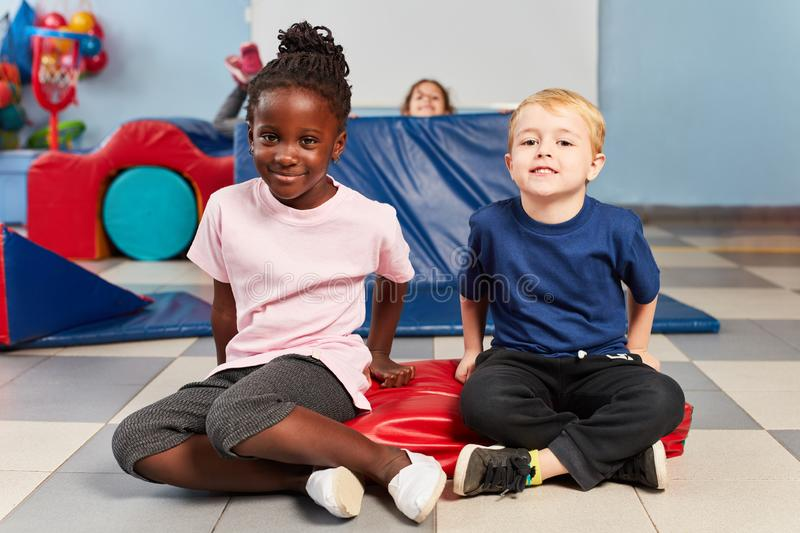 Two kids playing sports royalty free stock photography
