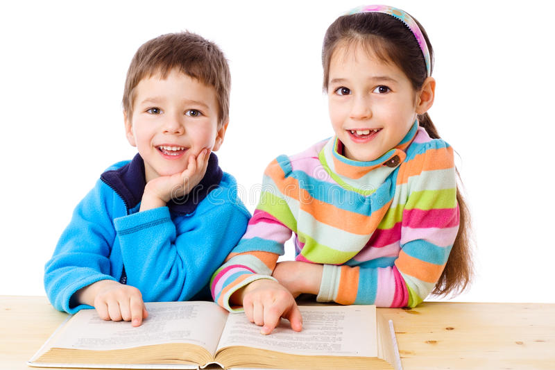 Two Kids Reading The Book Stock Image