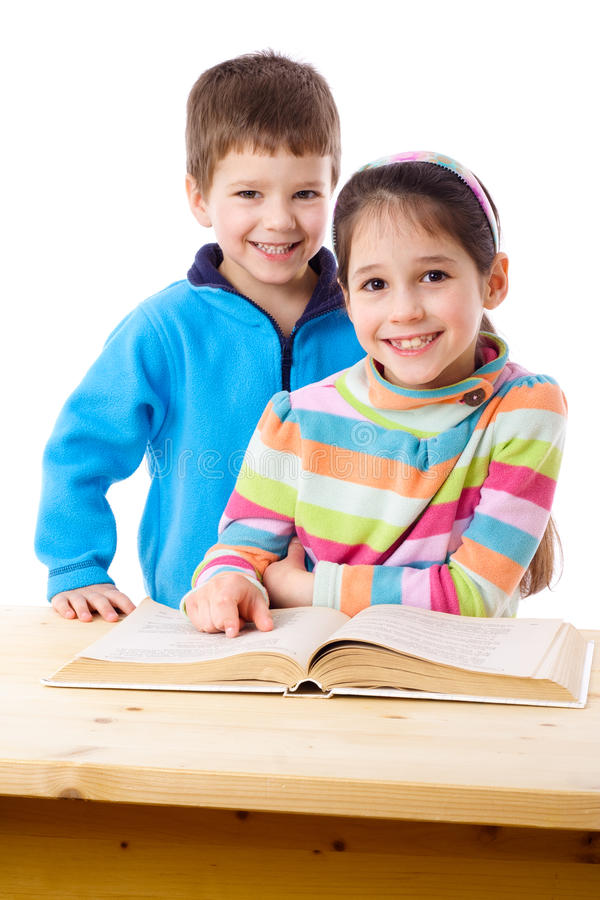 Two Kids Reading The Book Together Royalty Free Stock Photos