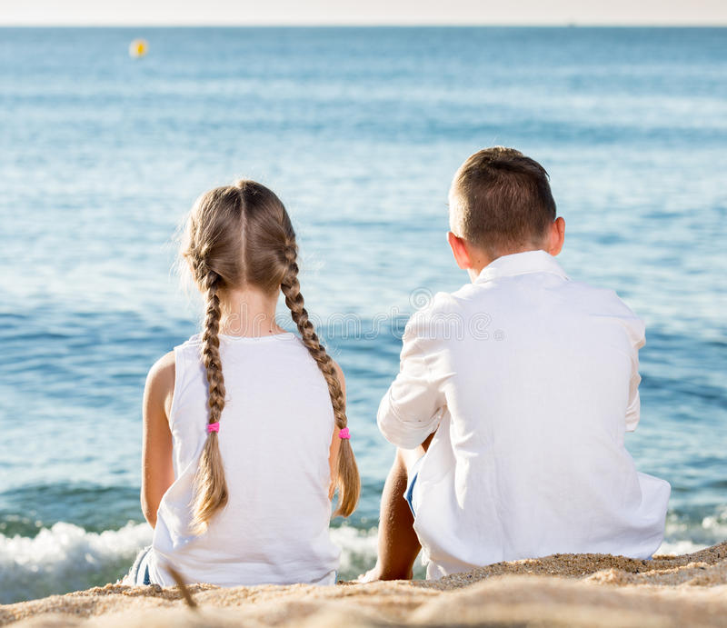 Two kids sitting back royalty free stock photos