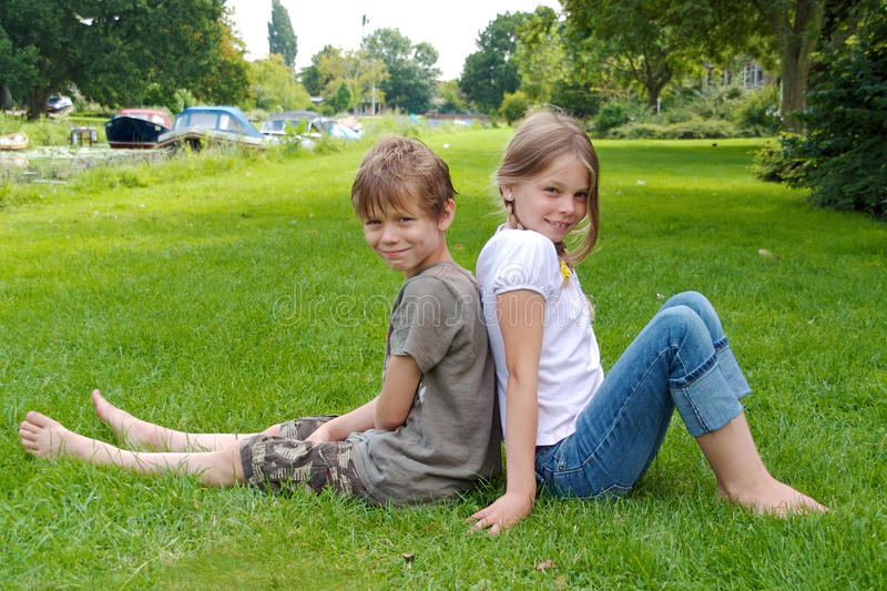 Download Two Kids Sitting Back To Back Stock Photo - Image: 10351034