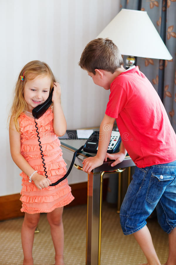 Download Two kids talking on phone stock photo. Image of communication - 29149634
