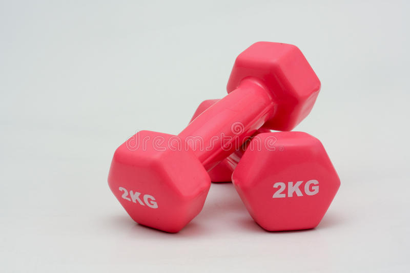 Two 2kilo weights. Image of a pair of two kilo hand weights, brightly colored stock photography